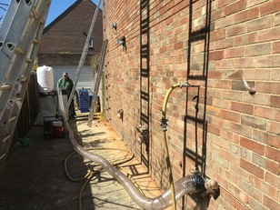 Cavity Wall Insulation being removed